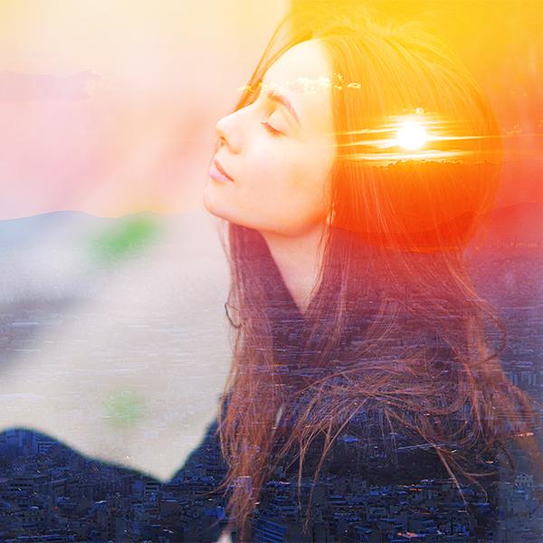women with eye closed sun